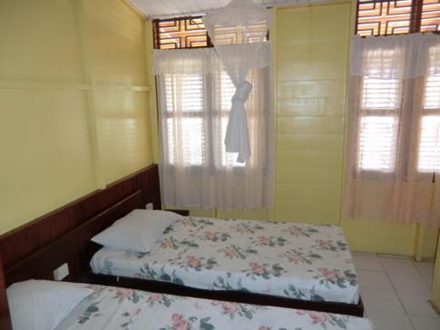 EIn Zweibettzimmer in Julies Guesthouse in Bequia