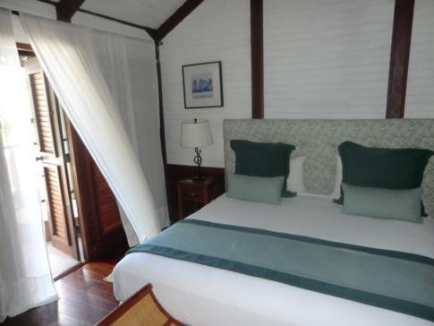 Ein Doppelzimmer im Tamarind Beach Hotel in Canouan